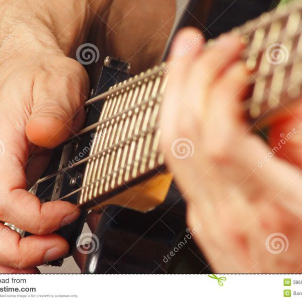 hands-musician-playing-electric-bass-guitar-closeup-close-up-39693140